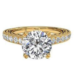 The braided micropavé gold band adds a touch of vintage glamour to this classic ring by Ritani.