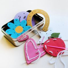 Made from hole punched simple wooden craft shapes- these sewing cards will entertain kids, while teaching them a skill. Full tutorial.
