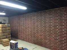 Painted brick form poured concrete basement walls with ceiling painted black
