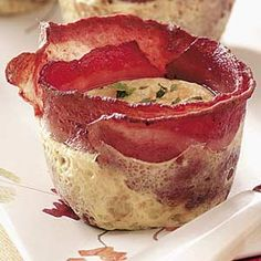 Bird's Nest Breakfast Cups: 12 turkey bacon strips, 1-1/2 cups egg substitute, 6 Tbs shredded reduced-fat Mexican cheese blend, 1 Tbs minced fresh parsley.   In a large skillet, cook bacon over medium heat for 2 minutes on each side or until partially set but not crisp. Coat six muffin cups with cooking spray; wrap two bacon strips around the inside of each cup. Fill each with 1/4 cup egg substitute; top with cheese.   Bake at 350° for 18-20 minutes or until set. Cool for 5 minutes