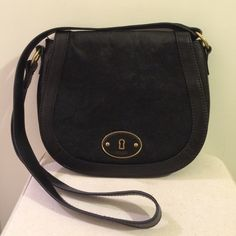 Fossil Vintage Reissue Black Calf Hair Crossbody This gorgeous leather bag is practical and so so cute! I love it!  When I take it shopping or to work it fits all sorts of things: my wallet, phone, book, snack, my makeup bag... For being my small purse, it always fits everything I want to bring with me! The leather is in perfect condition! Only wear is shown on the top of the purse where the calf hair has rubbed away. Last pic shows in detail. In person it looks like the light is hitting the…