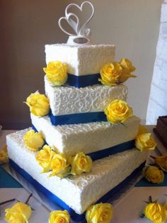 White, blue and yellow wedding cake - White buttercream frosting, blue ribbon with yellow roses. That would be perfect with daffodils instead of roses! Blue Yellow Weddings, Magenta Wedding, Wedding Colors, Square Wedding Cakes, Square Cakes, Beautiful Cakes, Amazing Cakes, Trendy Wedding, Dream Wedding