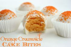 Orange Creamsicle Cake Bites--Orange-flavored cake crumbled and rolled together with buttercream frosting to make cake bites with orange creamsicle flavor.