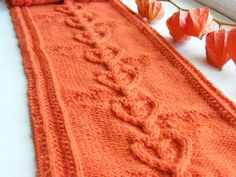 A beautiful scarf with a cabled hearts pattern.