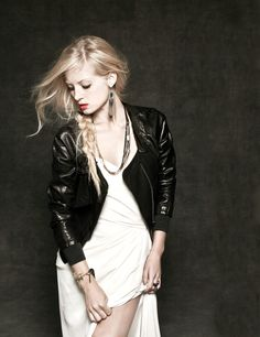 Black leather, heavy metal jewels and grungy accessories give classic bridal gowns a rocker vibe.