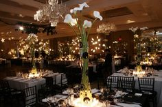 Larger-than-life lilies in polka dot vases are the perfect touch for a stylish black and white ballroom scene at @Four Seasons Hotel Boston.