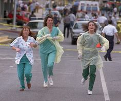 *OKLAHOMA CITY BOMBING:  Medical assistants, Janet Froehlich, lt, Wilma Jackson + Kerri Albright run from the Alfred Murrah Federal Building after being told another bomb device had been found, Wednesday, April 19, 1995, in Oklahoma City. An explosion ripped through the federal office building Wednesday morning.