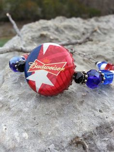 Check out this item in my Etsy shop https://www.etsy.com/listing/506993975/budweiser-beer-cap-bracelet-patriotic