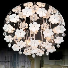 Exquisitely adorned with clear crystal strands, this flush mount emits a gleaming shimmer when halogen lamps are lit. The white glass flowers which are fixed with each sturdy chrome branch falling down from the canopy like that flowers leap from a tree. This beautiful and graceful flush ceiling fixture is a refreshing addition to a sophisticated room.