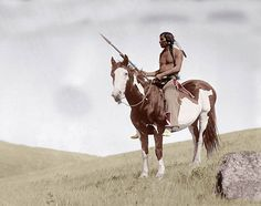 Circa 1900's Hand-tinted black and white photo.   http://old-photos.blogspot.com/2008/12/indian-on-pony.html