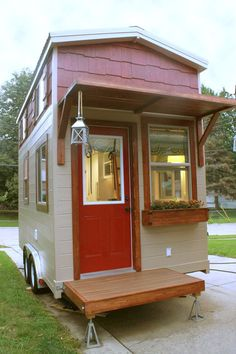 A 180 square feet lofted tiny house on wheels in Omaha, Nebraska. Designed and built by High Plains Tiny Homes.