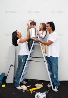 Happy family painting a room ...  beautiful, boy, brush, casual, cheerful, color, couple, daughter, decorating, decoration, design, domestic, family, girl, happiness, happy, helping, home, house, housework, improvement, indoors, interior, lady, man, new, owner, paint, paintbrush, painter, painting, people, person, relationship, renovate, renovating, renovation, room, smile, smiling, son, stepladder, teamwork, together, tool, wall, wife, woman, young
