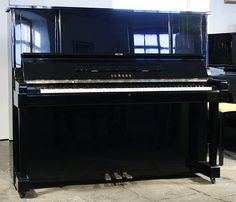 A 1982, Yamaha YUX upright piano with a black case and polyester finish at Besbrode Pianos £3500. http://www.besbrodepianos.co.uk/piano-sale/yamaha-YUX-upright-piano-1.htm