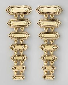 """14 karat gold-plated drop earrings. Studded tiers with granulated edges. 1"""" wide; 2 1/2"""" drop. Post backs. Imported."""