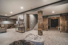 Well-appointed wood finishes add a hint of rustic appeal to this contemporary interior. The grey walls and carpet flooring serves as a backdrop for an understated modern vibe. Basement Makeover, Basement Renovations, Home Renovation, Home Remodeling, Rustic Basement, Basement House, Basement Bedrooms, Basement Plans, Man Cave Basement