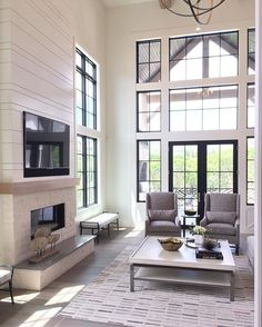 Those windows, that planked wall...everything is so perfect in this #homeshow living room. What's your favorite part? Shop the look of this space with @liketoknow.it.home. http://liketk.it/2psEz @liketoknow.it #liketkit #ltkhome. Designed by @erinhansendesign