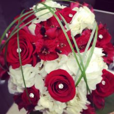 Red, White and Bling Bride Bq.  White hydrangea, red roses and alstroemeria with bear grass loops and salal to finish it off