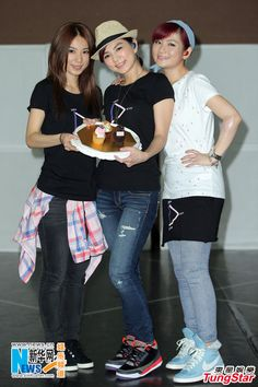 """Members of the pop group S.H.E celebrate the birthday of Ella (C) during the final rehearsal for their """"2GETHER 4EVER"""" World Tour 2013 in Taipei, Taiwan, June 18, 2013. The concert will be held at the Taipei Arena on June 22-23."""