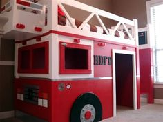 DIY a Fire Station loft bed, inspired by Pottery Barn Kids Firehouse Loft Bed. This bed features solid wood construction, clever use of materials, and easy panel design for moving and storing. Features ladder that can be placed on either side, an open back and wide entryway. Create extra room in your child's room on the tightest of budgets by making your own Fire Dept Loft Bed!