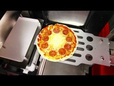 Vending Machine Makes a Fresh Pizza in 2 Minutes [VIDEO] : Ever really want a freshly baked pizza but don't have more than a few minutes to get one? A1 Concepts is distributing an Italian-made vending machine that can bake a whole pizza in two and a half minutes.    After the concept's initial success in Europe, it's now coming across the pond to the United States.