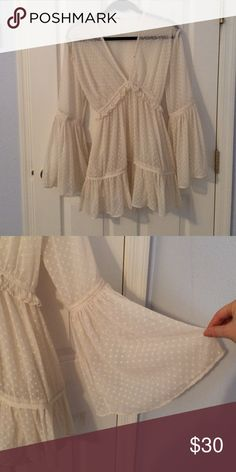 Free People Bell Sleeve Dress Boho dress / Sheer beige-cream colored fabric with some ruffle detailing / bell sleeves / ties at the waist Free People Dresses Long Sleeve