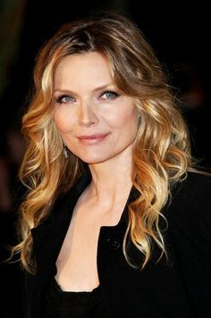 Michelle Pfeiffer  ....i totally disagree with the comments they placed below this picture....she's lovely as ever! ~*~moonmistgirl~*~