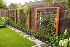 Wood-framed wire trellis - would be a beautiful trellis for  cucumbers.