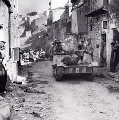Bren carriers in the town of Centuripe, Sicily, August 1943. 78th Division