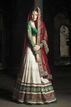 This is an A-cut lehenga skirt. Ethnic bridal lehenga in off-white, green and red.