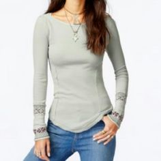 Long sleeve henley WORN ONCE. Nothing wrong with it. Cream henley with printed bottom sleeve. Form fitting. Very comfortable and soft. Stretchy. Size large but fits a medium. Free People Tops Tees - Long Sleeve