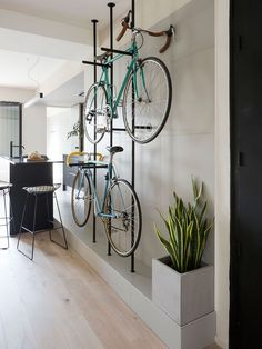 Bespoke storage creates room for bicycles in renovated Barcelona flat Colombo and Serboli Architecture has revamped a Barcelona apartment, opening up the partitions to create a large living space with a bespoke, wall-mounted bicycle rack. Bike Storage Room, Bike Storage Apartment, Indoor Bike Storage, Bicycle Storage, Bicycle Rack, Bike Storage Basement, Bicycle Decor, Storage Racks, Bicycle Wheel
