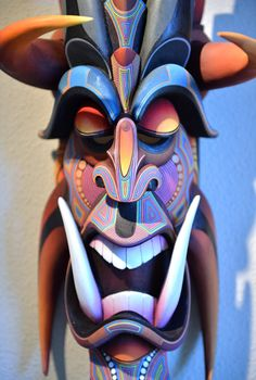This is one of the wooden masks The Boruca, an indigenous group,  would use to scare off Spanish invaders. They were originally made from cedar wood and depicted devils. This mask depicts a human-like saber tooth tiger.