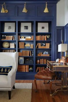Blue wall library with beautiful room furnishings.
