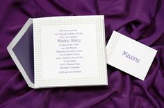 This deeply embossed border with pearl dots is a beautiful frame for this bright white invitation.