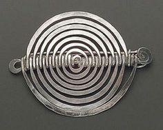Alexander Calder round scroll brooch, circa 1942.