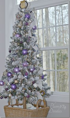 A purple white silver themed Christmas tree. Shades of purple, lavender, frosty white, and silver ornaments on a flocked Christmas tree. Purple Christmas Tree Decorations, Flocked Christmas Trees, Silver Christmas Tree, Christmas Colors, Beautiful Christmas, All Things Christmas, Christmas Themes, Silver Decorations, Coastal Christmas