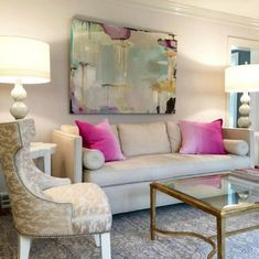 You will love the next home tour! Take a peek at this chic living room. Soothing gray colors colors are the perfect backdrop for the gorgeous abstract art.