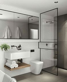 Colour palette of tiles and vanity (white top and wood cabinets)