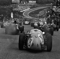 Louis Rosier (FRA), Maserati N°. Mike Hawthorn (GBR), Vanwall, at start of the 1955 Belgian Grand Prix, Circuit de Spa-Francorchamps. View downhill to Eau Rouge corner. Classic Sports Cars, Classic Cars, Maserati, Ferrari, F1 Posters, Course Vintage, Course Automobile, Belgian Grand Prix, Motorcycles