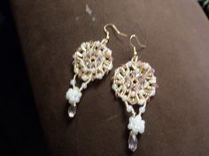 eight petal flowerette earrings with cubic right by MindForBeads
