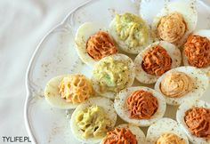 Stuffed Eggs with Sun-Dried Tomato, Salmon and Avocado fillings.  Scroll down for English.