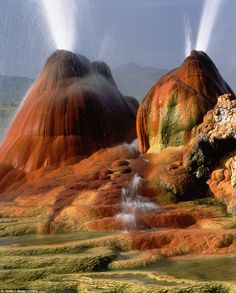 The Geiser Hot Springs: Fly Geyser, above, lies in the region around Black Rock Desert in Nevada, the dry bed of an ancient lake. Fly Geyser Nevada, Places To Travel, Places To See, Places Around The World, Around The Worlds, Beautiful World, Beautiful Places, Beautiful Scenery, Black Rock Desert