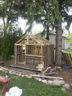 Fort made with used pallets and wood leftovers from a deck project.