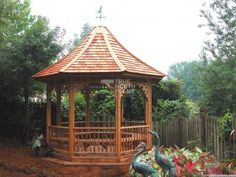 This Tattle Creek outdoor gazebo comes with lovely cedar shingles and is a great addition to your backyard to enjoy watch the summer night sunset. Hot Tub Gazebo, Patio Gazebo, Backyard, Outdoor Gazebos, Outdoor Structures, Large Gazebo, Raised Bed Garden Design, Gazebo Plans, Built In Bench
