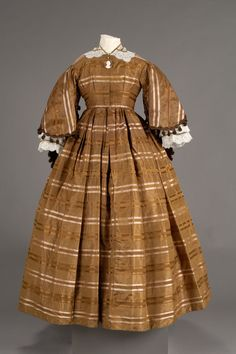 Brown taffeta dress the round neck with hook and eye closures down the front; bodice lining is off white cotton; skirt lining is brown taffeta. 1800s Clothing, Antique Clothing, Historical Clothing, Historical Society, 1850s Fashion, Victorian Fashion, Vintage Fashion, Victorian Dresses, Civil War Fashion
