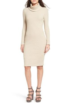 Look chic and cozy in this fab turtleneck sweater dress.