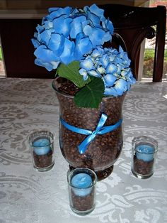 A Perfect Blend - Coffee Bridal Shower Theme - Tiffany Blue.  We used this idea for decorations, filled in with baby's breath and alternating blue & white votive candles.