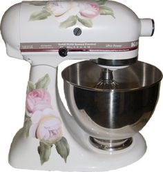 These peach or yellow and red or pink are actually a photo of hand painted roses. So the vinyl decal looks painted on your mixer. Kind of a vintage antique victorian fashion old country rose with some green vine type leaves, not modern, …