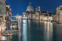 Venice At Night by videophotoart com            On the background: Santa Maria della Salute (English: Saint Mary of Health), commonly known simply as the Salute, is a Roman Catholic church and minor basilica located at Punta della Dogana in the Dorsoduro sestiere of the city of Venice, Italy. In 1630, Venice experienced an unusually devastating outbreak of the plague. As a votive offering for the city's deliverance from the pestilence, the Republic of Venice vowed to build and dedicate a…