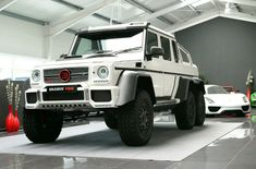 Mercedes-Benz G 63 AMG - Luxury Pulse Cars - Germany - For sale on LuxuryPulse. White G Wagon, Marine Steering Wheel, Mercedes 6x6, G 63 Amg, 6x6 Truck, Large Suv, Mercedez Benz, Roof Extension, Xenon Headlights